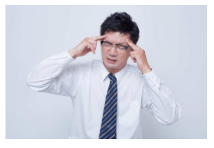頭痛がする男性